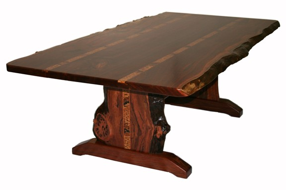 Solid timber jarrah table with natural edges and inlays