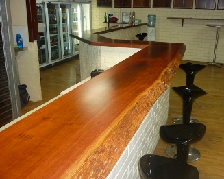 Jarrah natural edge bar top in football club rooms