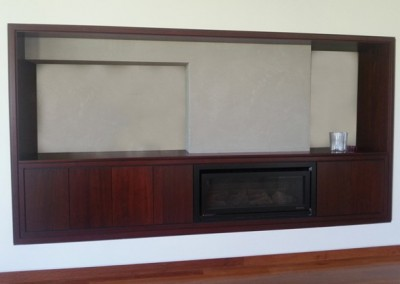 Jarrah cabinet surrounding fireplace